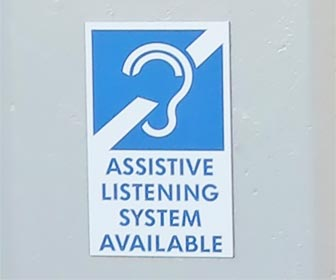 Assistive Listening System sign -- this sign is near the entrance at Dodger Stadium. [Photo Credit: LAtourist.com]