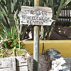 Sign at Knott's Berry Farm directs guests to the wheelchair and stroller rental station. [Photo Credit: LAtourist.com]