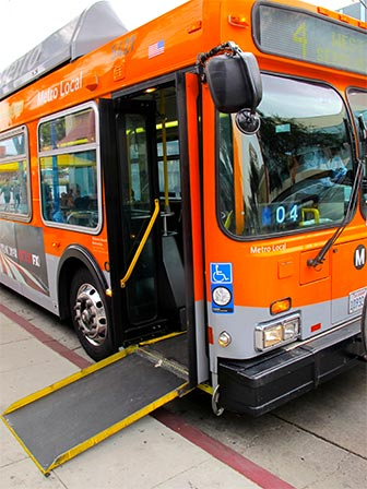 Los Angeles Metro buses have wheelchair accessible ramps and can lean over to assist passengers in boarding. [Photo Credit: LAtourist.com]