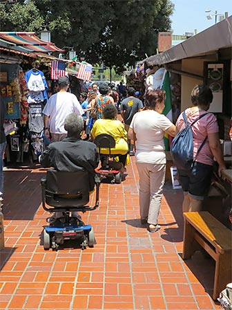 The brick tiled pathway at Olvera Street is easy to traverse. [Photo Credit: LAtourist.com]