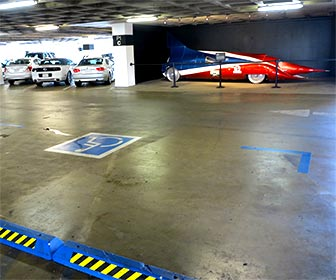 Parking lot at The Petersen auto museum. The Petersen  has exhibits in their garage, as well as inside the building. [Photo Credit: LAtourist.com]