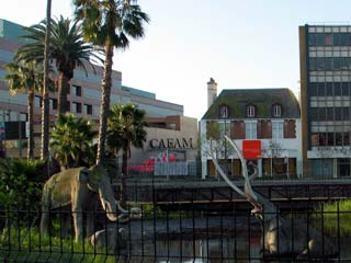 Foreground: Mammoths in LACMA's Lake Pit Walk. You can also see Craft and Folk Art Museum on the other side of Wilshire Blvd. [Photo Credit: LAtourist.com]