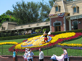Mickey Mouse greets visitors near the entrance of Disneyland. [Photo Credit: LAtourist.com]