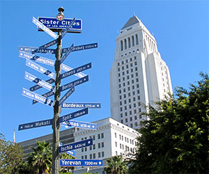 Sister Cities Sign and City Hall in Downtown Los Angeles. [Photo Credit: LAtourist.com]
