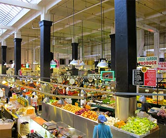 Fruit and vegetable stands at the Grand Central Market in downtown Los Angeles. [Photo Credit: LAtourist.com]