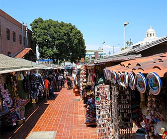 Olvera Street in Downtown Los Angeles, where the stores and restaurants have a theme of old Mexico. [Photo Credit: LAtourist.com]