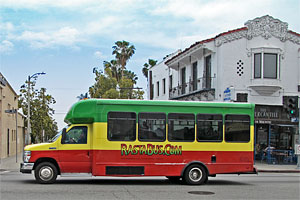 Rasta Bus (operated by A Day in L.A. tours) on Sunset Boulevard in Hollywood. [Photo Credit: LAtourist.com]