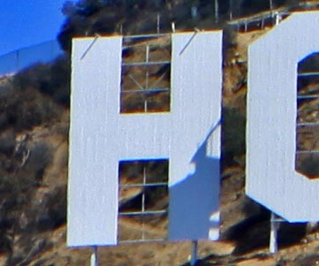 The letter H from the Hollywood Sign. The letters were originally 50 feet high, but now are slightly shorter at 45 feet. It is said to be haunted by the ghost of Peg Entwistle. Park rangers and hikers have reported seeing a young, blonde woman dressed in old-fashioned clothing who vanishes when approached. [Photo Credit: LAtourist.com]