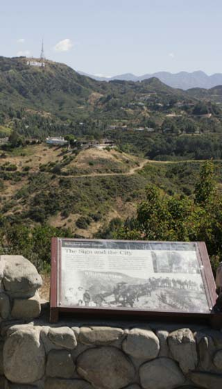 View of the Hollywood Sign from the Hollywood Bowl Overlook on Mulholland Drive in Los Angeles. [Photo Credit: LAtourist.com]