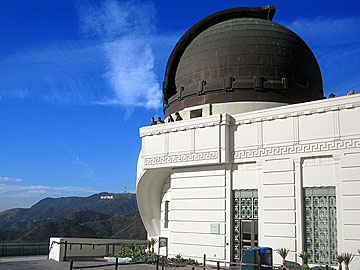 Griffith Observatory at Griffith Park in Los Angeles, California. The Hollywood Sign is in the background. [Photo Credit: LAtourist.com]