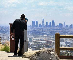Tourist at Hollywood Overlook on Mulholland Drive. [Photo Credit: LAtourist.com]