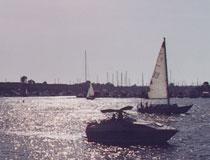 Boats sailing in Redondo Beach Harbor. [Photo Credit: LAtourist.com]