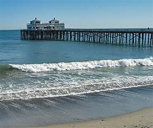 Malibu Pier on the Pacific Ocean, near Los Angeles. [Photo Credit: LAtourist.com]