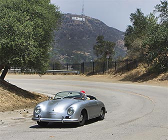 A motorist on Mulholland Drive near the Hollywood Bowl Overlook. The Hollywood Sign can be seen in the background. [Photo Credit: LAtourist.com]
