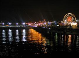 Santa Monica Pier at night. [Photo Credit: LAtourist.com]