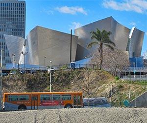 Metro Local Bus near Disney Hall in downtown Los Angeles. [Photo Credit: LAtourist.com]