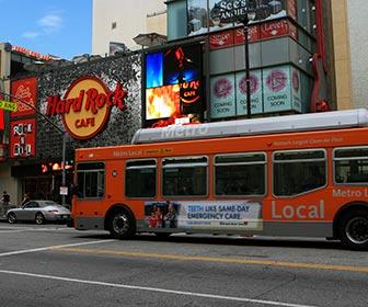 Metro Local Bus near the Hard Rock Cafe at Hollywood & Highland Center on Hollywood Boulevard. [Photo Credit: LAtourist.com]