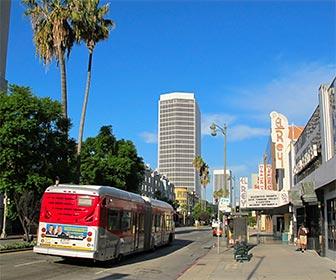 Metro Rapid 720 Bus on Wilshire Boulevard near El Rey Theatre. [Photo Credit: LAtourist.com]
